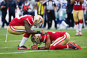 San Francisco 49ers strong safety Jaquiski Tartt (29), left, supports free safety Eric Reid (35) after a missed interception against the Dallas Cowboys at Levis Stadium in Santa Clara, Calif., on October 2, 2016. (Stan Olszewski/Special to S.F. Examiner)
