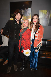 Left to right, Alex Zane, Erica Bergsmeds and Iraira Mancini at an exhibition of photographs by Erica Bergsmeds held at The Den, 100 Wardour Street, London England. 19 January 2017.