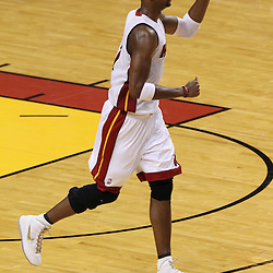 Jun 21, 2012; Miami, FL, USA; Miami Heat power forward Chris Bosh (1) reacts after scoring against the Oklahoma City Thunder during the third quarter in game five in the 2012 NBA Finals at the American Airlines Arena. Mandatory Credit: Derick E. Hingle-US PRESSWIRE