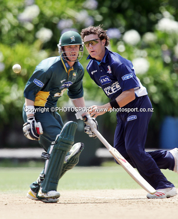Auckland's Rob Nicol fields off his own bolwing during the State Shield cricket match between the Auckland Aces and Central Stags at Eden Park, Auckland, on Wednesday 31 January 2007. Photo: Renee McKay/PHOTOSPORT