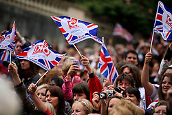 UK ENGLAND LONDON 29APR11 -  Crowds of onlookers cheer and wave Union Jack flags as  TRH Prince William, Duke of Cambridge and Catherine, Duchess of Cambridge go past the Mall following their marriage at Westminster Abbey on April 29, 2011 in London, England.  The event has been watched on TV by an estimated two billion people.....jre/Photo by Jiri Rezac....© Jiri Rezac 2011