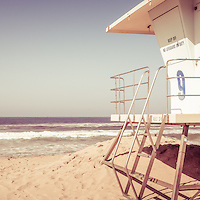 Panorama photo of a Huntington Beach lifeguard tower with retro vintage 1970's tone. Panoramic picture ratio is 1:3. Huntington Beach is a seaside beach city in Orange County Southern California and is also known as Surf City USA.