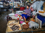 20 APRIL 2015 - BANGKOK, THAILAND:  A woman sells fish and seafood in Talat Phlu, a market in the Thonburi section of Bangkok.    PHOTO BY JACK KURTZ