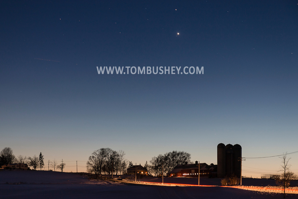 Goshen, New York - The planets Venus and Mars shine above a farm on a cold winter evening on Feb. 17, 2015.
