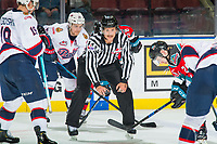 KELOWNA, CANADA - NOVEMBER 21:  Linesman Dustin Minty prepares to drop the puck between \v19 and Kyle Topping #24 of the Kelowna Rockets on November 21, 2018 at Prospera Place in Kelowna, British Columbia, Canada.  (Photo by Marissa Baecker/Shoot the Breeze)