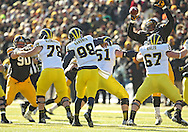 November 23 2013: Michigan Wolverines quarterback Devin Gardner (98) has a passed knocked down by Iowa Hawkeyes defensive lineman Carl Davis (71) during the second quarter of the NCAA football game between the Michigan Wolverines and the Iowa Hawkeyes at Kinnick Stadium in Iowa City, Iowa on November 23, 2013. Iowa defeated Michigan 24-21.