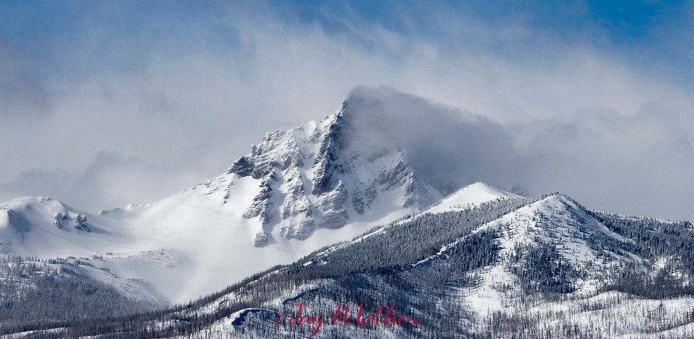 High winds whip up the snow on Three-Fingered Jack near Camp Sherman, Oregon.