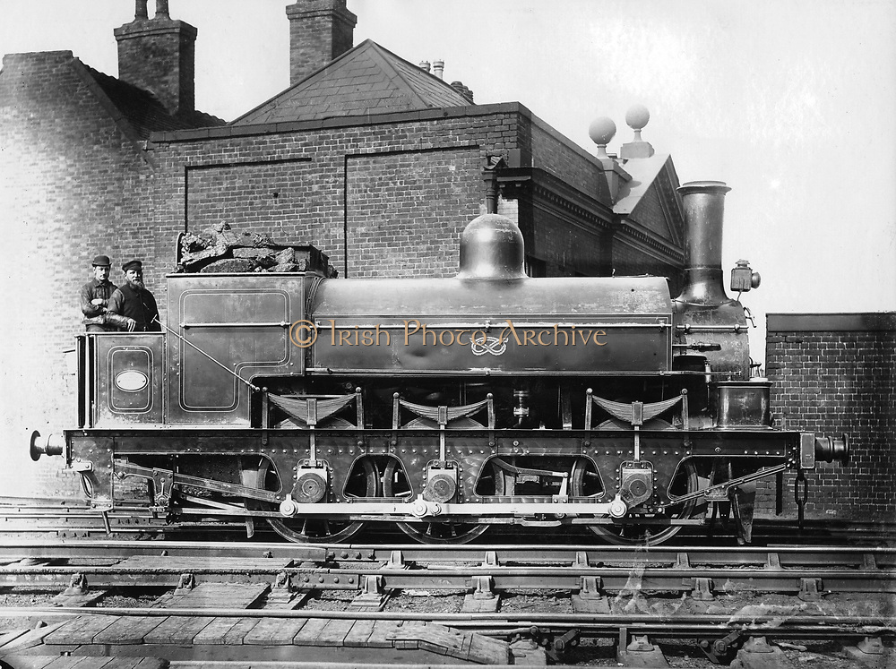 North Staffordshire 0-6-0 steam locomotive with driver and fireman on the footplate. 19th century. Photograph.