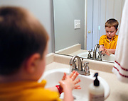 Evan Costik, 6, washes his hands after dinner in Livonia, N.Y. on August 27, 2014.<br /> <br /> Evan has type 1 diabetes, and his father, John, modified a continuous glucose monitor and an Android smartphone to provide constant updates on Evan's blood sugar remotely. CREDIT: Mike Bradley for the Wall Street Journal<br /> MEDIHACK