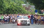 Middletown, New York - Runners and their police car escort at the starting line of the 16th annual Ruthie Dino-Marshall 5K Run/Walk put on by the Middletown YMCA on Sunday, June 10, 2012. ©Tom Bushey / The Image Works