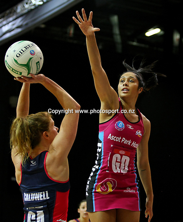 Steels Phoenix Karaka defends Vixens Tegan Caldwells shot at goal in the ANZ championship netball match, Steel v Vixens, ILT Stadium Southland, Invercargill, New Zealand, Saturday, May 31, 2014. Photo: Dianne Manson / www.photosport.co.nz