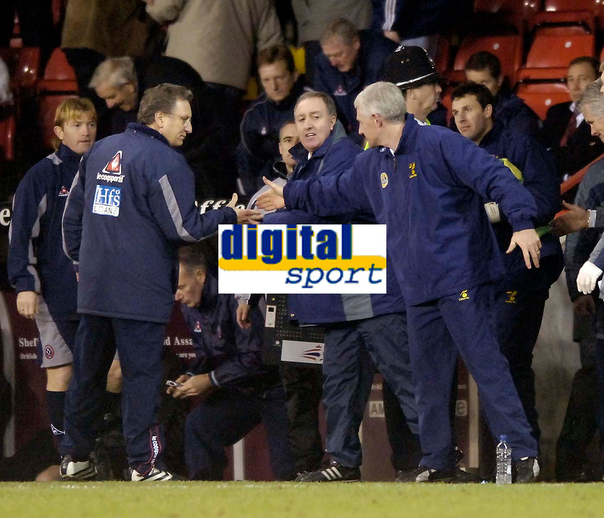 Photo: Jed Wee.<br />Sheffield United v Norwich City. Coca Cola Championship.<br />26/12/2005.<br />Norwich manager Nigel Worthington (R) shakes hands with Sheffield United counterpart Neil Warnock.