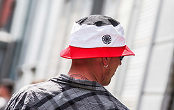 "May 25, 2019 - Dortmund, Nordrhein Westfalen, Germany - A neonazi in Dortmund, Germany wears a hat with the colors of Germany's 1933-35 flag with a Black Sun nazi esoteric embroidery.  Prior to the European Elections, the neonazi party Die Rechte (The Right) organized a rally in the German city of Dortmund to promote their candidate, the incarcerated Holocaust denier Ursula Haverbeck.  The demonstration and march were organized by prominent local political figure and neonazi activist Michael Brueck (Michael Brück) who enlisted the help of not only German neonazis, but also assistance from Russian, Bulgarian, Hungarian, and Dutch groups with the final tally ranging from 180-250.  The police reported various incidents, including forbidding the use of a banner with former President of Iran Ahmadenijad, who the group states is an ally.  Later, the parade was stopped due to the use of ""here we are, the national resistanceâ (Credit Image: © Sachelle Babbar/ZUMA Wire)"