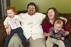 """For Michael Hilliard, an active, 37-year-old husband and father of two small children, being robbed of his independence was a major blow to his self-worth. <br /> <br /> That feeling of helplessness fueled his desire to return as quickly as he could to being the man his family counts on.<br /> On the morning of Sunday, Dec. 6, Hilliard woke up feeling tired, with slight weakness in his left side. With two children under age three, he chalked it up to sleep deprivation — the norm for he and his wife, Amy. The family went to church as usual, with Hilliard napping that afternoon. <br /> By Monday morning, the symptoms had worsened. Hilliard's speech was beginning to slur and his balance was """"off,"""" so he went to a local emergency room. As it turns out, he was having a mild stroke.<br /> """"We knew something was wrong, but I thought I was too young for a stroke,"""" Hilliard said. """"I thought it might be MS or something else.""""<br /> <br /> Michael was photographed at his home with his wife Amy, daughter Lily and son Rory, Thursday, Jan. 28, 2016 at  in ."""