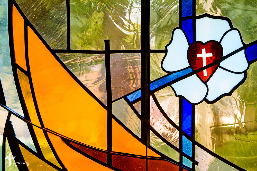 Stained glass depicting Martin Luther and the Luther seal at Lutheran Church of St. John, Quincy, Ill., on Sunday, June 11, 2017. LCMS Communications/Erik M. Lunsford