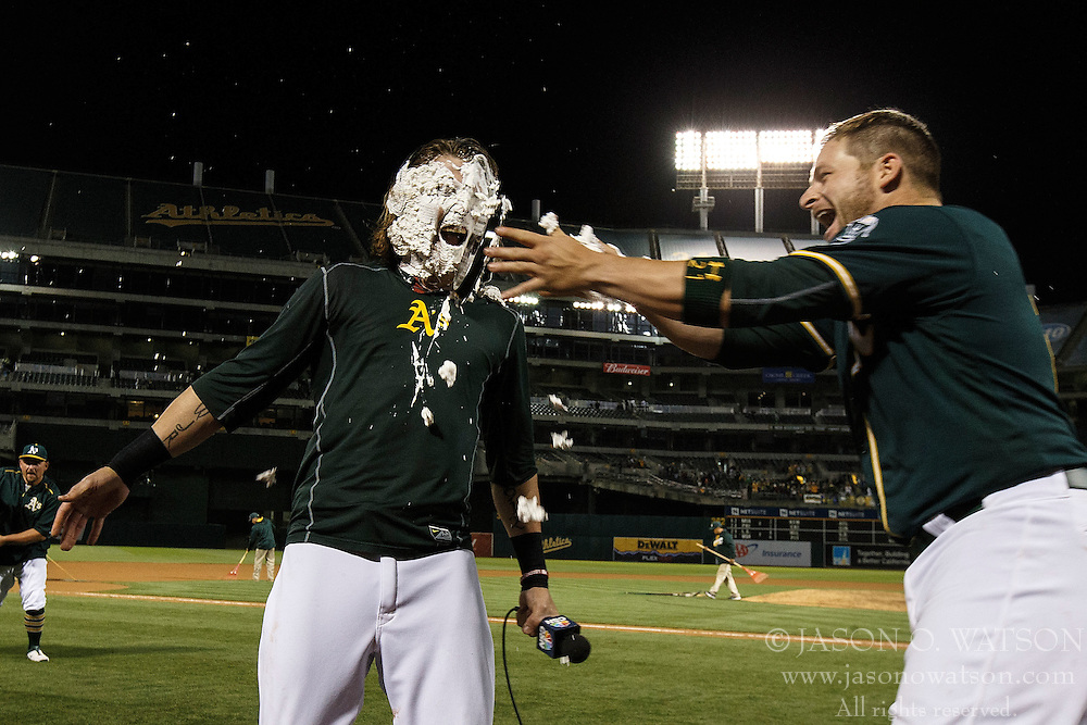 OAKLAND, CA - JULY 19:  Stephen Vogt #21 of the Oakland Athletics hits Josh Reddick #22 with pie in the face after the game against the Houston Astros at the Oakland Coliseum on July 19, 2016 in Oakland, California. The Oakland Athletics defeated the Houston Astros 4-3 in 10 innings.  (Photo by Jason O. Watson/Getty Images) *** Local Caption *** Stephen Vogt; Josh Reddick