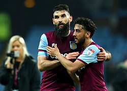 Mile Jedinak of Aston Villa hugs Neil Taylor of Aston Villa after their side's win over Leeds United - Mandatory by-line: Robbie Stephenson/JMP - 13/04/2018 - FOOTBALL - Villa Park - Birmingham, England - Aston Villa v Leeds United - Sky Bet Championship