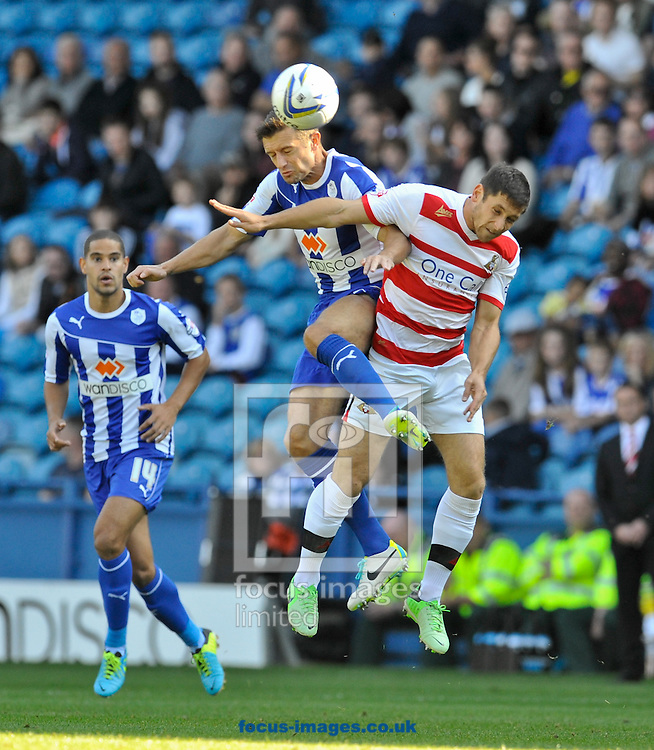 Picture by Richard Land/Focus Images Ltd +44 7713 507003<br /> 28/09/2013<br /> Stephen McPhail of Sheffield Wednesday and Paul Quinn of Doncaster Rovers during the Sky Bet Championship match at Hillsborough, Sheffield.