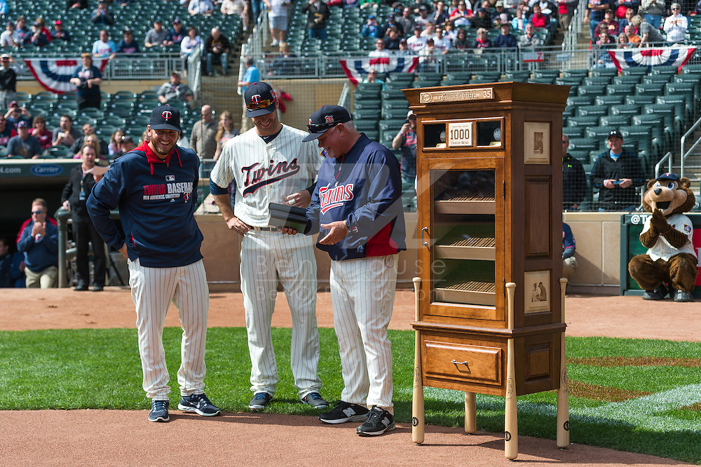 Glen Perkins #15 and Joe Mauer #7 of the Minnesota Twins congratulate manager Ron Gardenhire #35 during a pre-game ceremony celebrating his 1000th managerial win from earlier in the season on April 9, 2014 at Target Field in Minneapolis, Minnesota. Photo by Ben Krause
