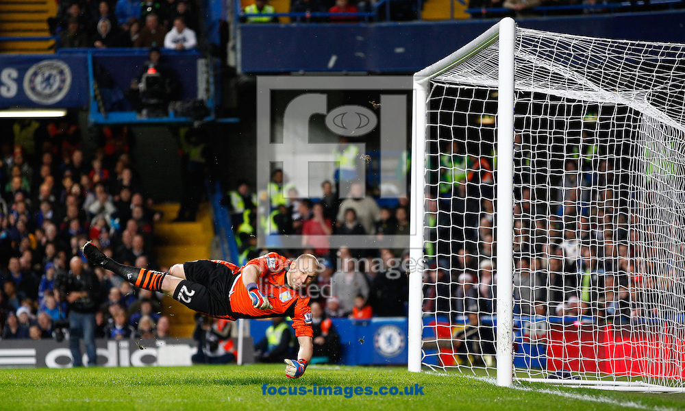 Picture by Andrew Tobin/Focus Images Ltd +44 7710 761829.23/12/2012.Brad Guzan  of Aston Villa can't save David Luiz  of Chelsea's free kick during the Barclays Premier League match at Stamford Bridge, London.
