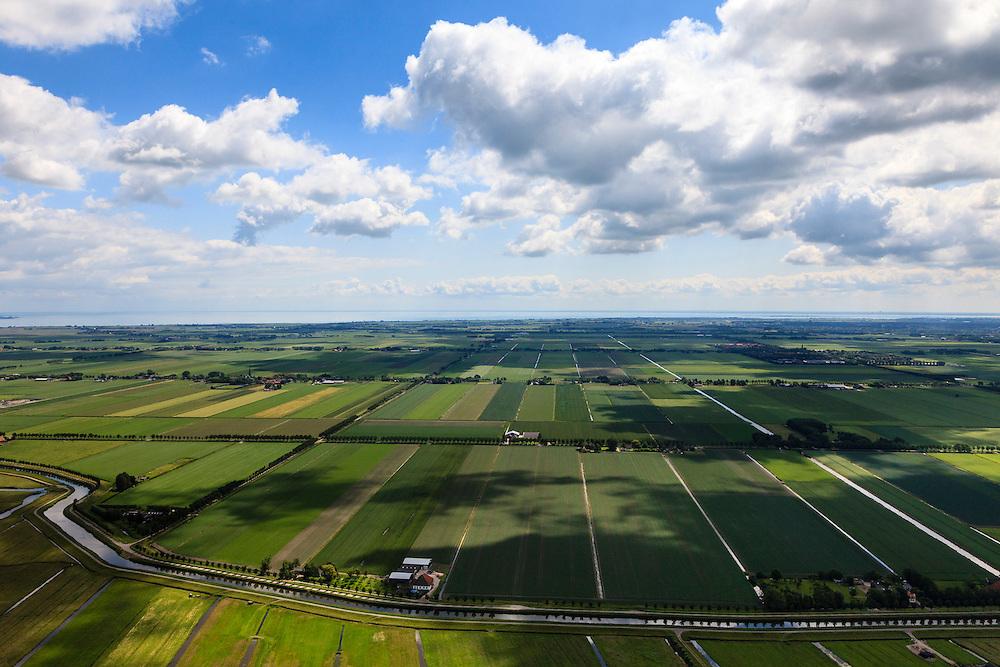 Nederland, Noord-Holland, Beemster, 14-06-2012; De Beemster, 400 jaar 1612 - 2012. Overzicht van de Boven polder in oostelijk richting (vanuit het Westen).  IJsselmeer aan de horizon. In de voorgrond de Beemsterrringvaart). De 17e eeuwse droogmakerij, met haar  beroemde geometrische verkaveling, maakt deel uit van het wereld erfgoed (Unesco werelderfgoedlijst).The famous geometrical well-ordered polder Beemster, 17th century  reclaimed landscape, Unesco world heritage..luchtfoto (toeslag), aerial photo (additional fee required);.copyright foto/photo Siebe Swart