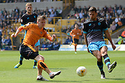 Sheffield Wednesday defender Vincent Sasso attempts to block Wolverhampton Wanderers striker Joe Mason effort during the Sky Bet Championship match between Wolverhampton Wanderers and Sheffield Wednesday at Molineux, Wolverhampton, England on 7 May 2016. Photo by Alan Franklin.