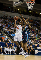 Virginia guard Monica Wright (22) shoots against ODU.  The #11 ranked / #5 seed Old Dominion Lady Monarchs defeated the #24 ranked / #4 seed Virginia Cavaliers 88-85 in overtime in the second round of the 2008 NCAA Women's Basketball Championship at the Ted Constant Convocation Center in Norfolk, VA on March 25, 2008.