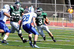 17 September 2011: T.J. Stinde looks for running room against Rex Layne III during an NCAA Division 3 football game between the Aurora Spartans and the Illinois Wesleyan Titans on Wilder Field inside Tucci Stadium in.Bloomington Illinois.