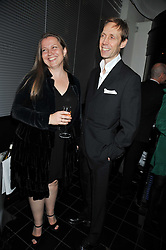 NICK KNIGHT and his wife CHARLOTTE at a dinner hosted by Alexandra Shulman editor of British Vogue in association with Net-A-Porter.com to celebrate 25 years of London Fashion Week and Nick Knight held at Le Caprice, Arlington Street, London on 21st September 2009.