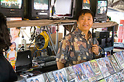 Hmong salesman age 40 selling Asian videos. Hmong Sports Festival McMurray Field St Paul Minnesota USA