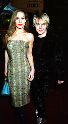 MISS TARA PALMER-TOMKINSON and musician MR NICK RHODES,  at a party in London on 29th January 2000.OAM 114