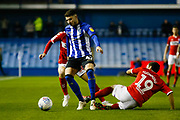 Sheffield Wednesday defender Matt Penney (42) is tackled by Middlesbrough midfielder Stewart Downing (19)  during the EFL Sky Bet Championship match between Sheffield Wednesday and Middlesbrough at Hillsborough, Sheffield, England on 19 October 2018.
