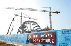 Exclusive - Construction in Istanbul's New Airport. The first phase of Istanbul's new airport is due to open in October 2018, and once it is complete, it is expected to become the world's busiest airport. Istanbul New Airport will be constructed over an area of 76.5 million square meters to the north of İstanbul, 35km away from the city centre. The construction will be carried out in four phases, and the first is scheduled to open on 29 October, Turkey's Republic Day. It will comprise of three runways and a terminal with a capacity for 90 million passengers. Once complete, the new airport will have six runways and will host flights going to more than 300 destinations. It will have an annual passenger capacity of up to 200 million people, making it the world's busiest airport. Photo by Tolga Adanali/Depo Photos/ABACAPRESS.COM