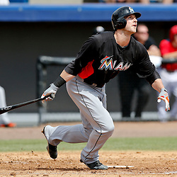 Mar 9, 2013; Melbourne, FL, USA; Miami Marlins first baseman Joe Mahoney (25) hits a two run homerun scoring Christian Yelich during the top of the third inning of a spring training game against the Washington Nationals at Space Coast Stadium. Mandatory Credit: Derick E. Hingle-USA TODAY Sports