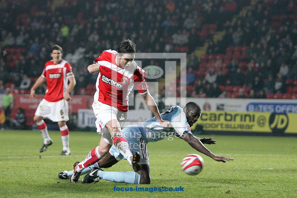 London - Monday December 15th, 2008: Andy Gray (L) of Charlton Athletic shrugs off Derby County's Darren Powell to score his side's first goal during the Coca Cola Championship match at The Valley, London. (Pic by Mark Chapman/Focus Images)