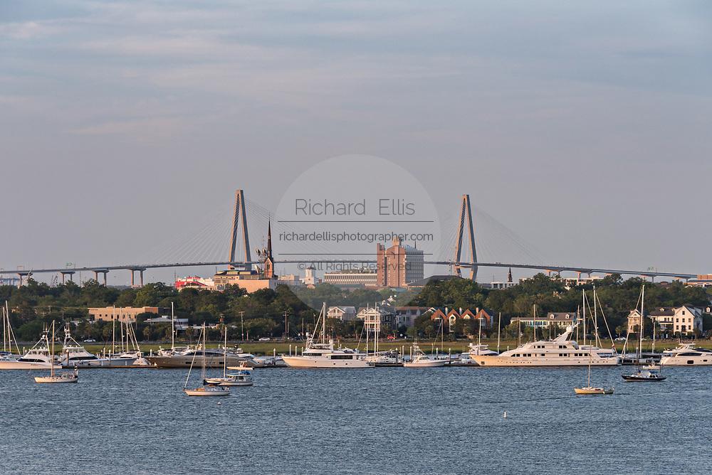 Arthur Ravenel Jr. Bridge and city skyline along the Ashley River at sunset in Charleston, South Carolina.
