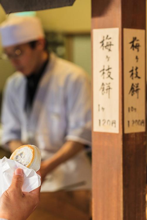 Sampling Umegae Mochi – sweet red bean paste in mochi (rice cake) in Dazaifu.
