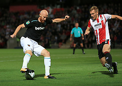 James Collins of West Ham United tries to turn inside Jamie Grimes of Cheltenham Town - Mandatory by-line: Paul Roberts/JMP - 23/08/2017 - FOOTBALL - LCI Rail Stadium - Cheltenham, England - Cheltenham Town v West Ham United - Carabao Cup