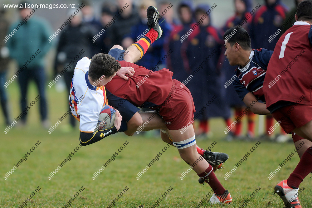 Henry Sullivan of John McGlashan is tackled, during the Southern Wide Realestate match between Kavanagh College 1st XV and John McGlashan College 1st XV, held at Kettle Park, Dunedin, New Zealand, 13 June 2015. Credit: Joe Allison / allisonimages.co.nz