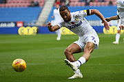 Leeds United midfielder Kemar Roofe (7) shoots at goal during the EFL Sky Bet Championship match between Wigan Athletic and Leeds United at the DW Stadium, Wigan, England on 4 November 2018.