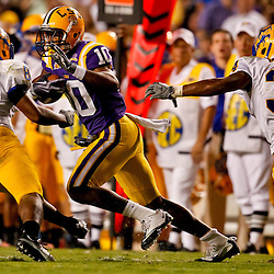 October 16, 2010; Baton Rouge, LA, USA; LSU Tigers wide receiver Russell Shepard (10) is pursued by McNeese State Cowboys cornerback Seth Thomas (8) and safety Malcolm Bronson (34) during the first half at Tiger Stadium.  Mandatory Credit: Derick E. Hingle