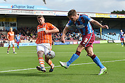 Scott Laird shoots towards goal blocked by Jim McAlister  during the Sky Bet League 1 match between Scunthorpe United and Blackpool at Glanford Park, Scunthorpe, England on 5 September 2015. Photo by Ian Lyall.