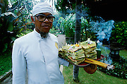 Jimbaran Beach. Daily offerings to the gods at Keraton Bali Hotel.