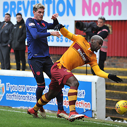 Kyle Lafferty (Hearts) and Cedric Kipre (Motherwell) during the Scottish Cup quarter final between Motherwell and Hearts at Fir Park, where the home side made it into the semi final draw with a win.<br /> <br /> <br /> (c) Dave Johnston | sportPix.org.uk