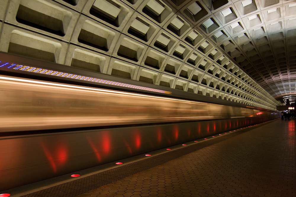A departing train in motion as it pulls out of the station at the Foggy Bottom GWU underground Metro station in Washington, DC