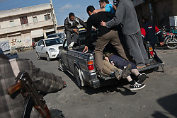 The dead bodies of five members of the free Syrian army lies at the back of a pickup in their funeral mourned by relatives and neighbours across Anadan, north Syria, saturday, April 21, 2012..Saturday morning eight members of the FSA and one civilian were killed by the result of an ambush made by mercenaries and security forces close to a checkpoint in the outskirts of Babis, north Aleppo. ..Amar Ateek,19. Ahmad Howari, 20..Abo Khattab Alsifrini, 19..Omar Mohamed Ali, 20..Mahmod Nakkar, 28..*In this town, 10 persons have been found dead,15 wounded and one missing in an attack were 18 tanks, 14 military cars and around 300 soldiers burned down 118 houses and 120 shops in a operation by the Syrian regime of Bashar-Al-Assad at April 13th and 14th activist says, Syria, April 21, 2012. Photo by Daniel Leal-Olivas / i-Images...