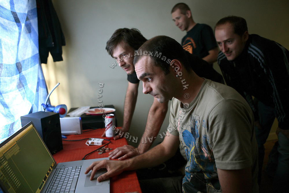 (from left to right) Lulu, 33, from Romania, Johnny, 29, from Croatia, Zil, 23, from Poland, and Calin, 30, from Romania, are staring at Johnny's computer while he is playing some music in his room, inside the Wildwood Road mansion on Sunday, July 22, 2007, in Hampstead, London, England. Situated opposite Hampstead Heath, North London's green jewel the average price for properties on this road reaches £ 2,500,000. Million Dollar Squatters is a documentary project in the lives of a peculiar group of squatters residing in three multi-million mansions in one of the classiest residential neighbourhoods of London, Hampstead Garden. The squatters' enthusiasm, their constant efforts to look after what has become their home, their ingenuity and adventurous spirit have all inspired me throughout the days and nights spent at their side. Between the fantasy world of exclusive Britain and the reality of squatting in London, I have been a witness to their unique story. While more than 100.000 properties in London still lay empty to this day, squatting provides a valid, and lawful alternative to paying Europe's most expensive rent prices, as well as offering the challenge of an adventurous lifestyle in the capital.