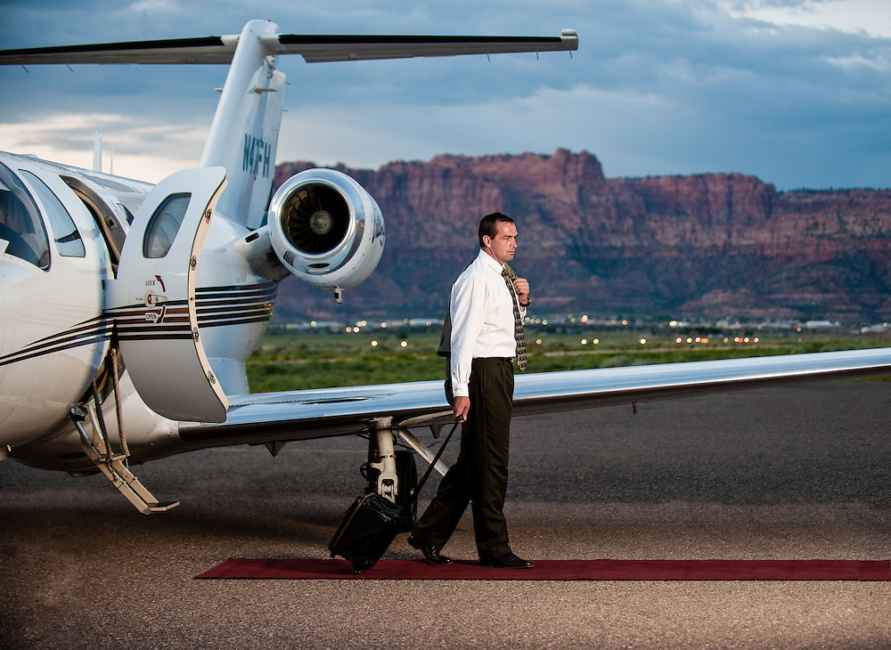 Image of executive at the airport exiting a citation jet at Colorado City Muncipal Airport in Arizona.