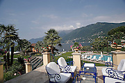 Svizzera, Ascona, la darsena e il giardino dell'hotel Eden Rock, considerato tra i più confortevoli in Svizzera...........Switzerland,  Canton Ticino, Ascona, the dock and garden of Eden Rock Hotel, considered one of the most confortable in Switzerland Lake Maggiore and its valleys are alpine landscapes that merge into typically Mediterranean scenery, where popular traditions are combined with internationally renowned events, and villages, in which time seems to have stood still, peep down from their lofty peaks on towns that are looking to the future. Fascinating contrasts that make this a unique region