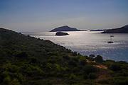 The beach and Mediterranean Sea at sunset, Cape Sounion, Attica, Greece